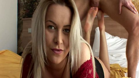Attractive blonde massages fat balls with her feet and gives a great footjob