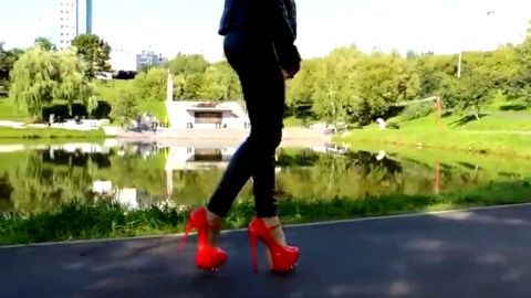 red high heels walking in street