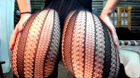 Curly haired woman with exotic butt cheeks dancing on cam in nylon stockings