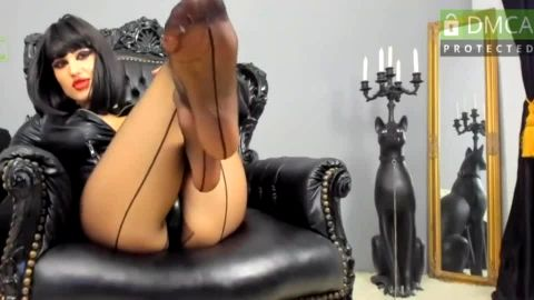 Webcam mistress wears nothing but sexy leather jacket and nylon stockings